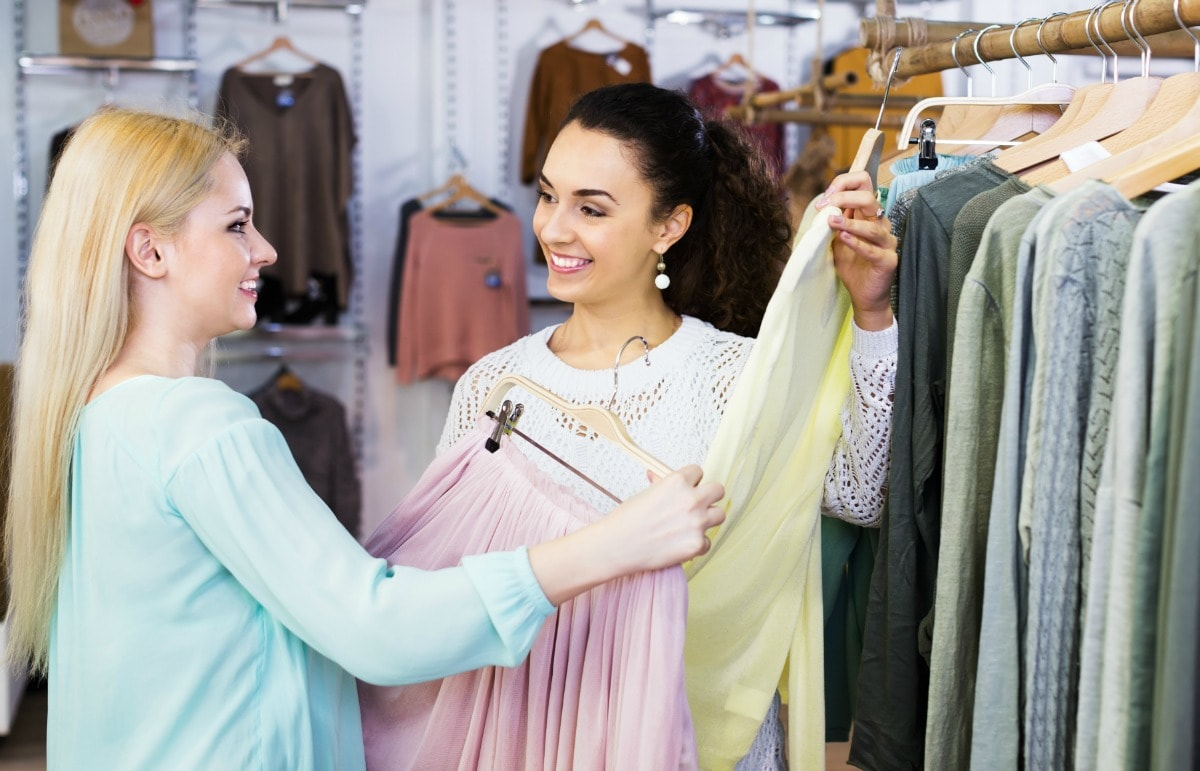 Saleswoman cross-selling and upselling a customer